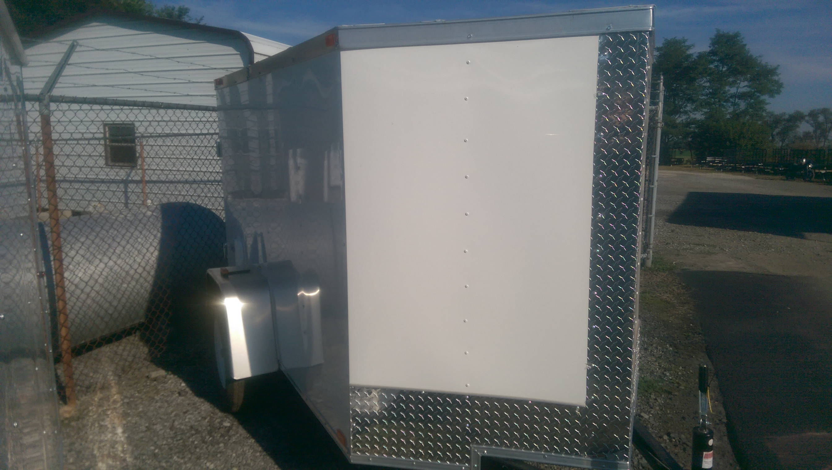 Quantity: 1  Single Rear Door with Bar Lock Plywood Flooring Rock Guard Interior Height  - 5' Aluminum Fenders Aluminum Exterior 4-Way Plug  <strong>Cash Price: $2,660</strong>  *Full Purchase Price does not include Title Fees and Taxes *3% Credit Card Surcharge added to Credit Card Purchases  	Financing not available on Freedom Trailers