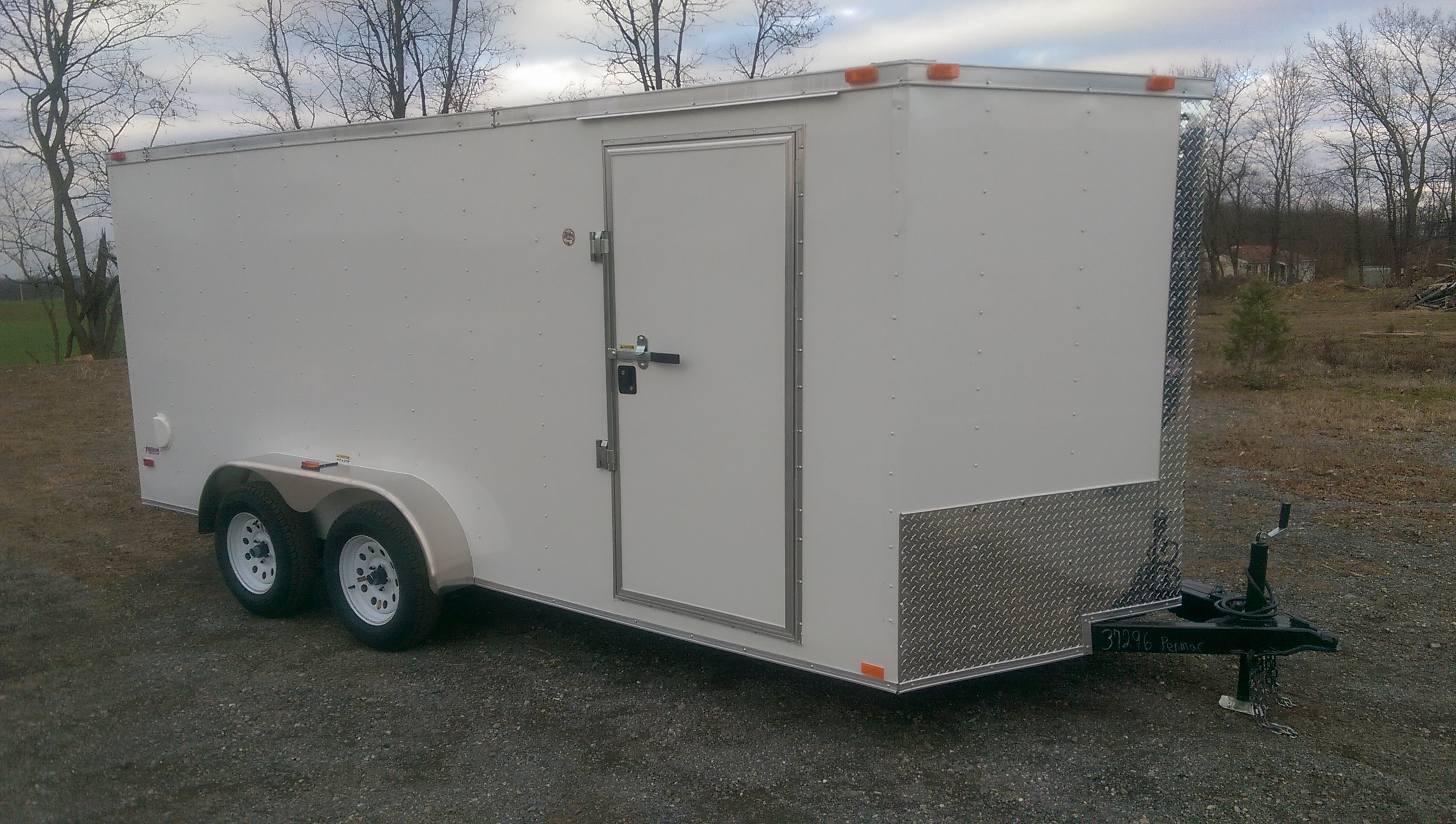 "Quantity: 1  Ramp Rear Door V-Nose Plywood Flooring 32"" Side Door Flush Lock and Bar Lock on Side Door Rock Guard Interior Height  - 75"" (3"" Extra Height) Aluminum Exterior 7-Way Plug  <strong>Cash Price: $4,380</strong>  *Full Purchase Price does not include Title Fees and Taxes *3% Credit Card Surcharge added to Credit Card Purchases  	Financing not available on Freedom Trailers"