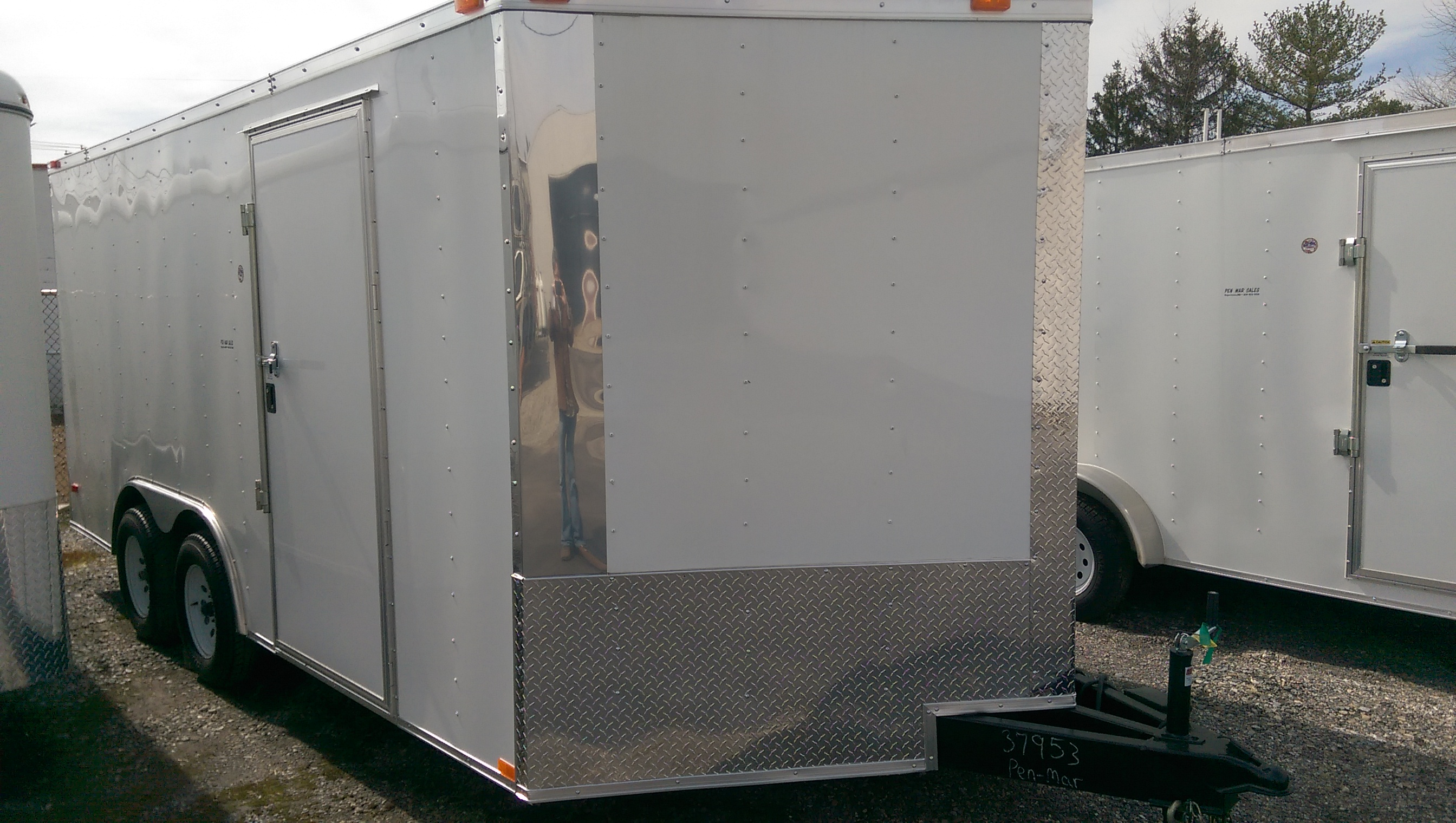 "Quantity: 1  Ramp Rear Door V-Nose Plywood Flooring 32"" Side Door Flush Lock and Bar Lock on Side Door Rock Guard Interior Height  - 75"" (3"" Extra Height) Aluminum Exterior 7-Way Plug  <strong>Cash Price: $5,100</strong>  *Full Purchase Price does not include Title Fees and Taxes *3% Credit Card Surcharge added to Credit Card Purchases  	Financing not available on Freedom Trailers"