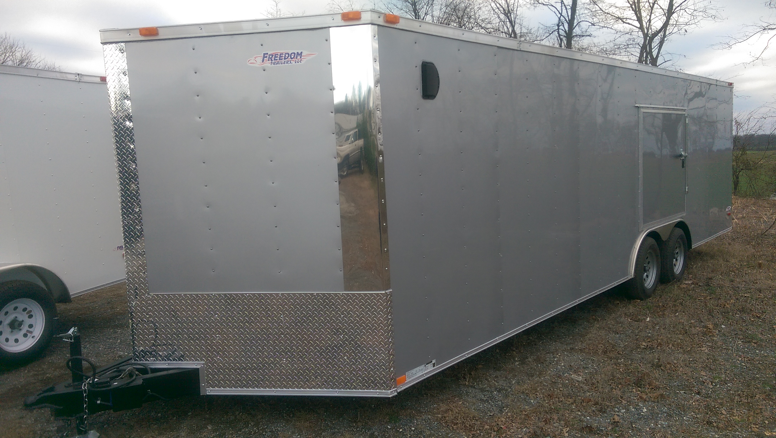"Quantity: 0  Ramp Rear Door Plywood Flooring 36"" Side Door 54"" Escape Door Rock Guard Interior Height  - 78"" Aluminum Fenders Aluminum Siding Galvalume Steel Roof Interior Lighting 7-Way Plug  <strong>Cash Price: $6,325</strong>  *Full Purchase Price does not include Title Fees and Taxes *3% Credit Card Surcharge added to Credit Card Purchases  	Financing not available on Freedom Trailers"